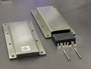 NEMA 2 (left) and NEMA 4/4X (right) Cable Exit Cover Plate Options