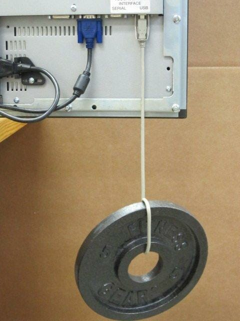 Showing the strength of our USB cable retention bracket with a 5 pound weight